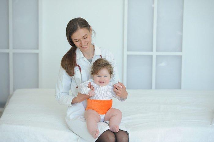 пояс при коликах у новорожденного