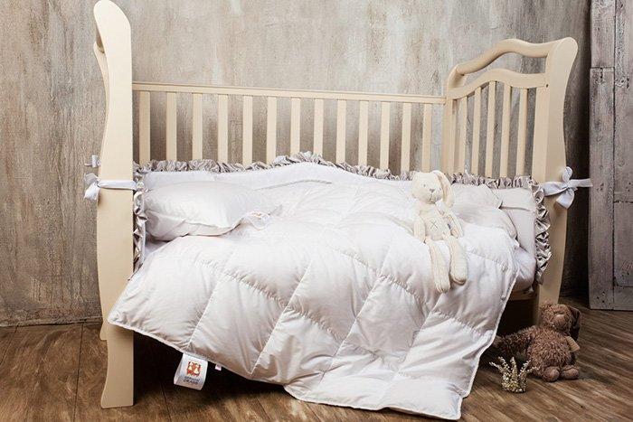 одеяло в кроватку ребенка